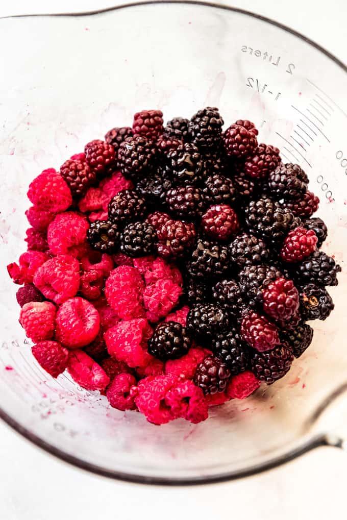 Raspberries and blackberries in a bowl