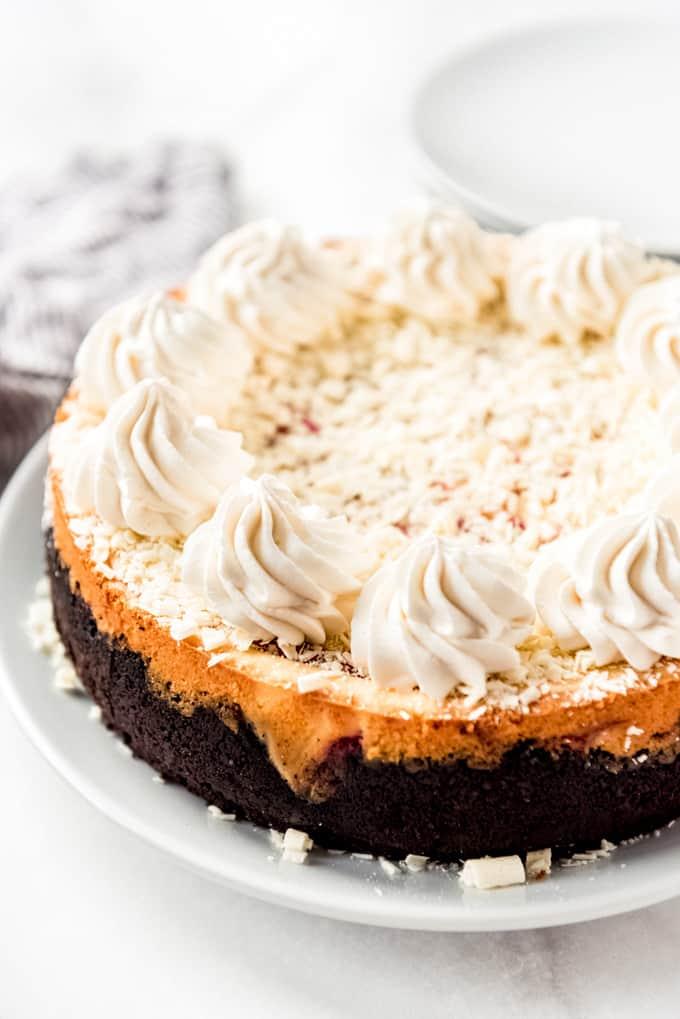 White Chocolate Raspberry Cheesecake uncut, side view
