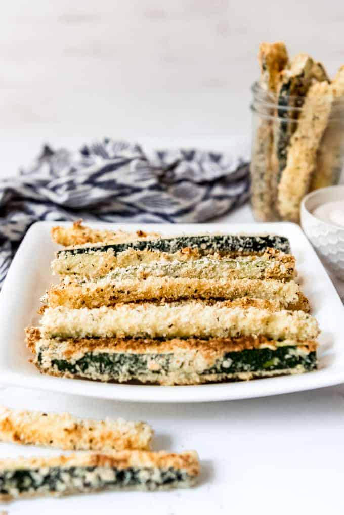 Healthy zucchini fries stacked on a plate.