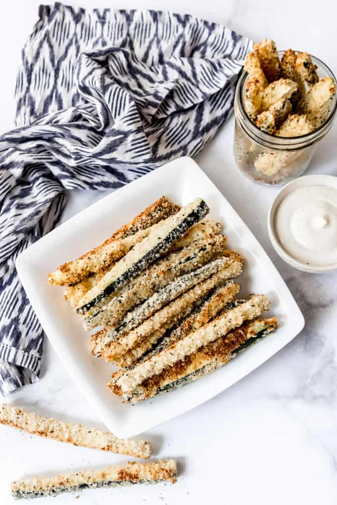 Zucchini fries on a white plate.