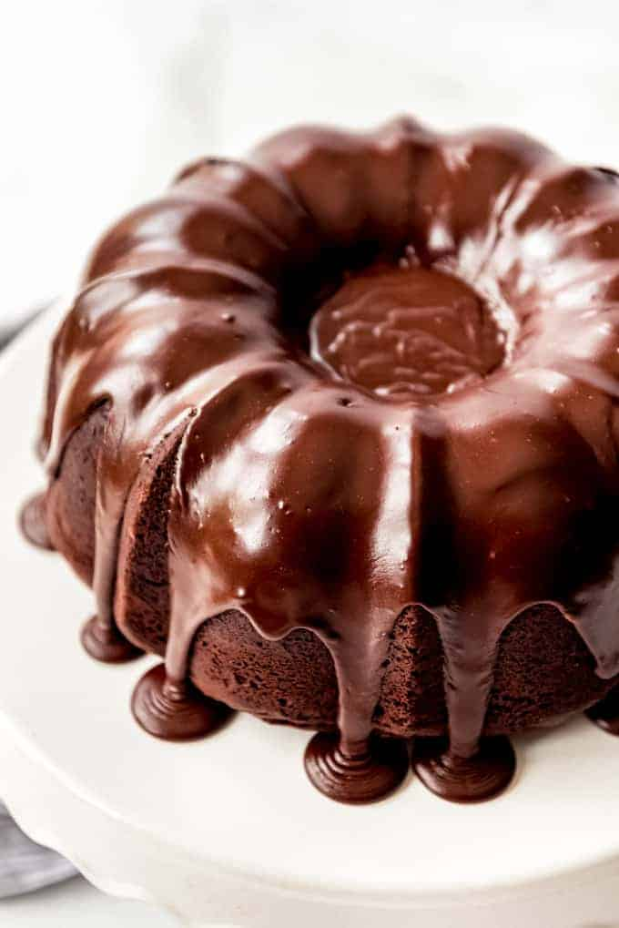 chocolate bundt cake completely covered and filled with icing