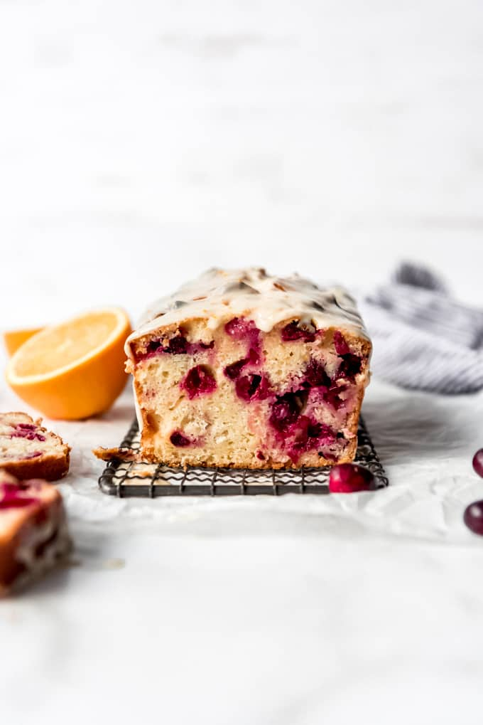 A sliced loaf of cranberry orange bread.