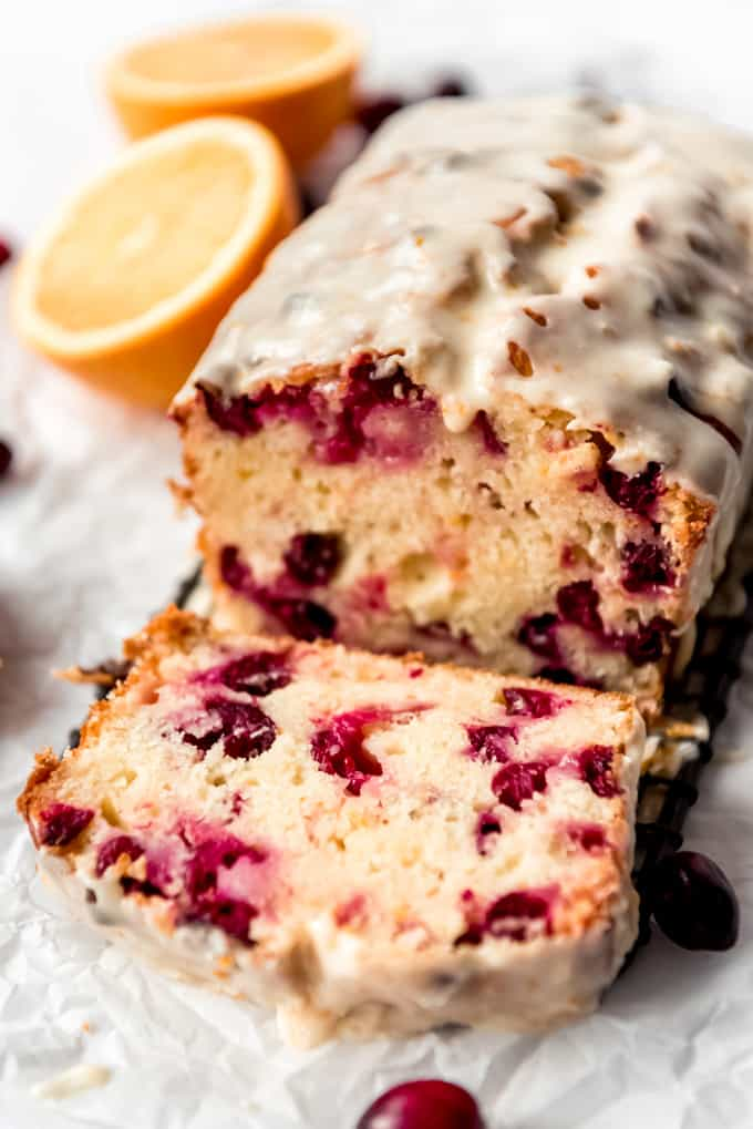 A close image of the inside of a loaf of cranberry orange bread.