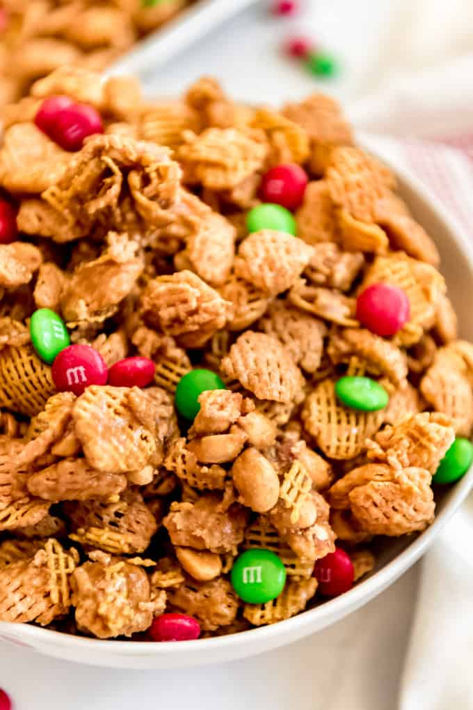 Clusters of crispix cereal and peanuts in a bowl.