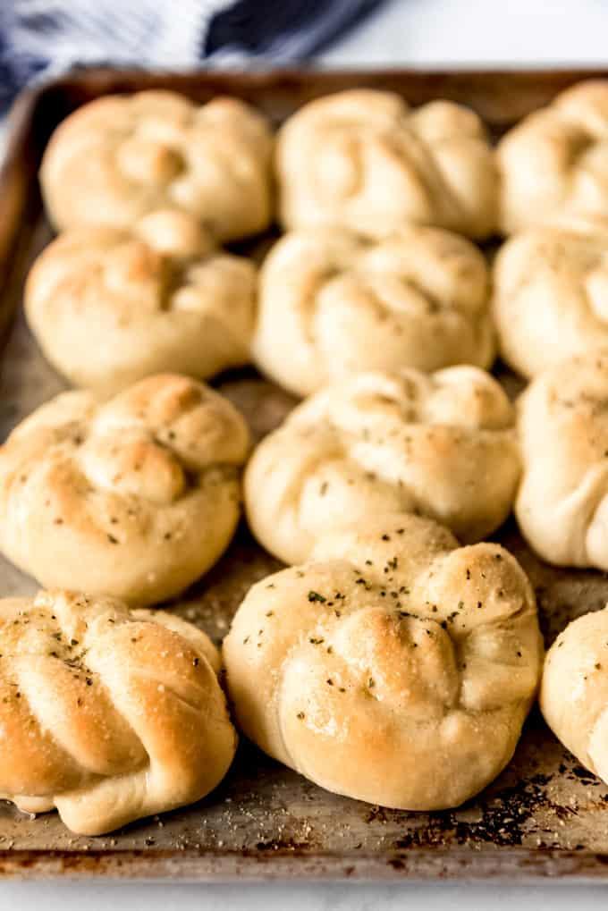 freshly baked garlic knots on baking tray