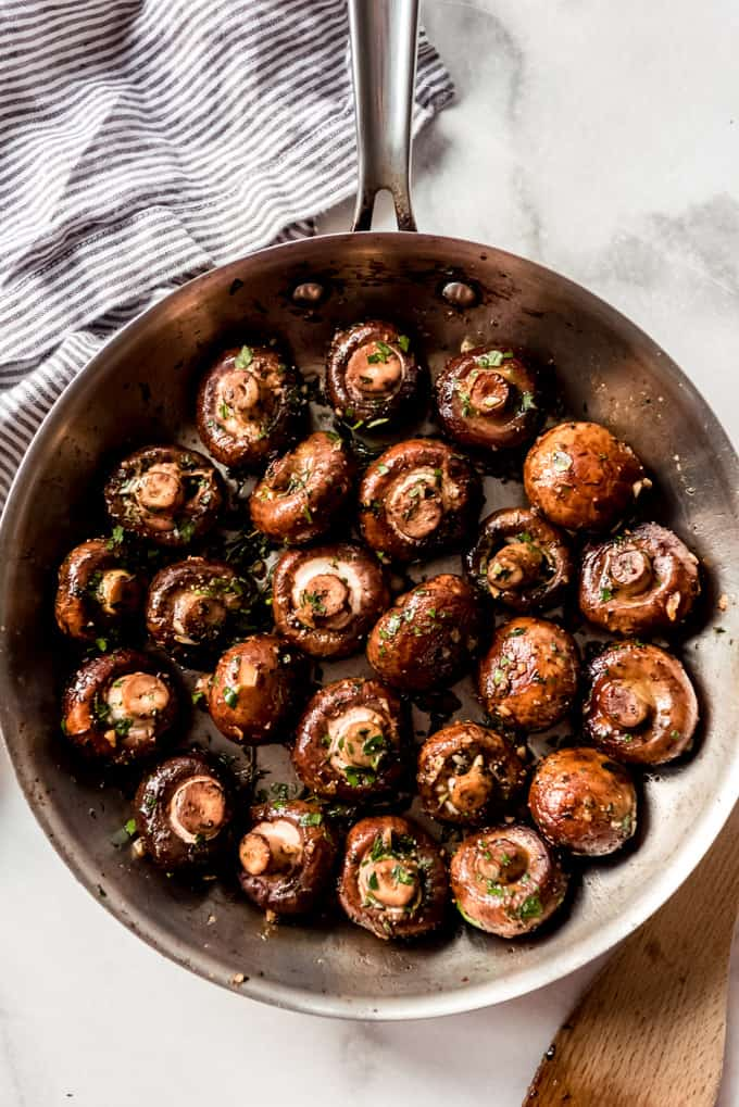 Buttery mushrooms in a skillet.