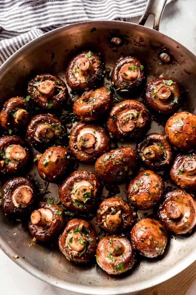 Sauteed mushrooms in a pan.