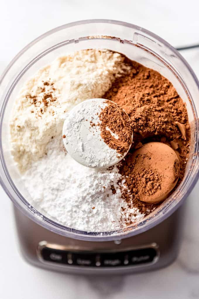 The ingredients for making homemade hot chocolate mix in a food processor.