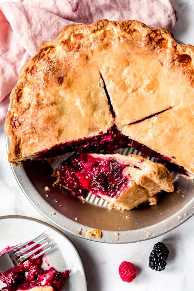 Razzleberry Pie in pie tin, with slice on it's side.