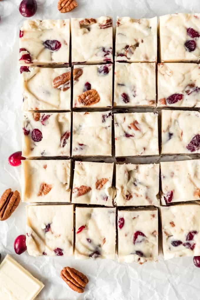 A batch of white chocolate cranberry pecan fudge cut into pieces.