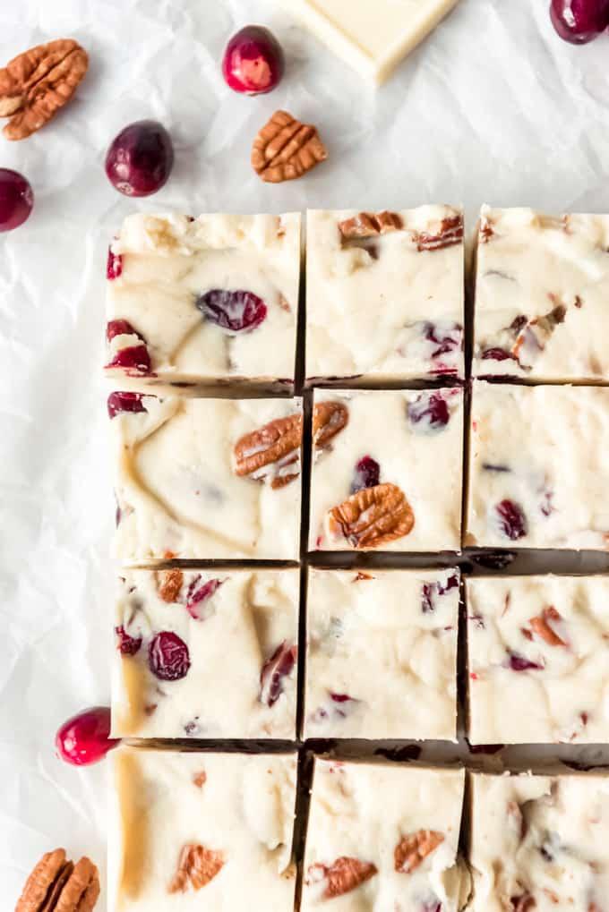 Squares of white chocolate cranberry pecan fudge.