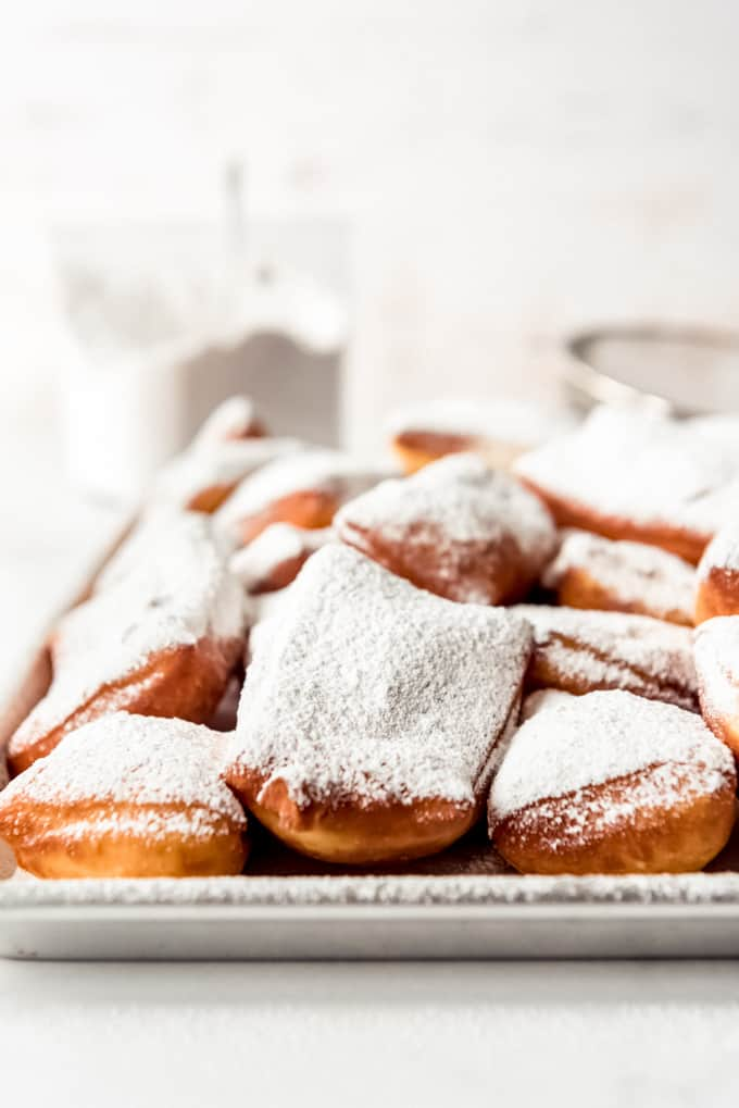 Beignets dusted with powdered sugar.