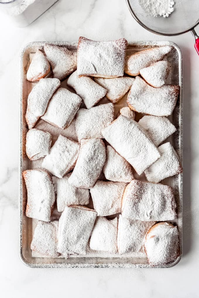 Beignets on a baking sheet.
