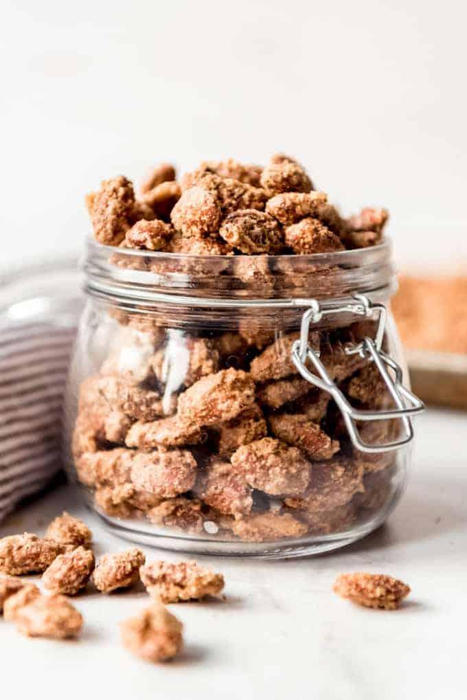 Sugared almonds in a glass jar.