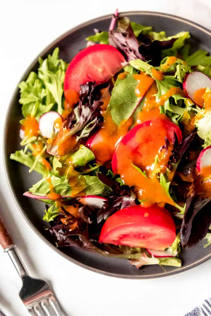 bright and colorful salad with dressing