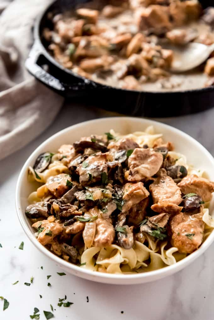 bowl of chicken stroganoff with pan in background