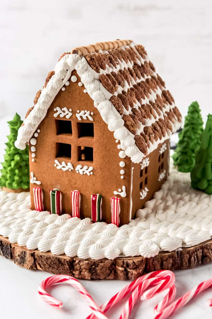 A gingerbread house decorated with royal icing, candy, and almonds.