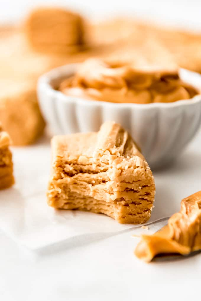 A piece of peanut butter fudge with a bite out of it.