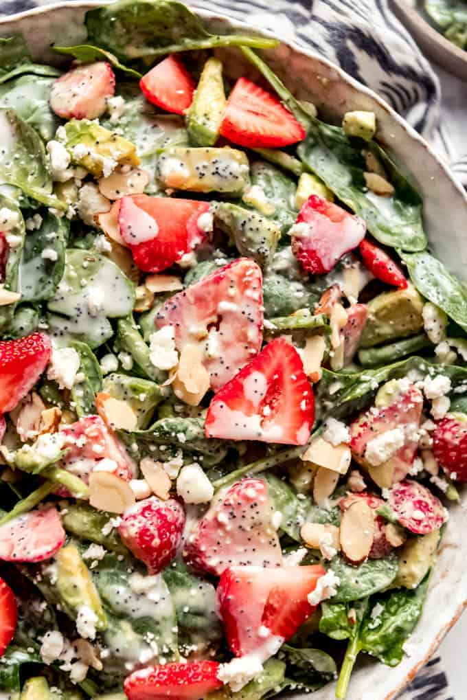 Strawberry spinach salad with avocado, almonds and poppy seed dressing