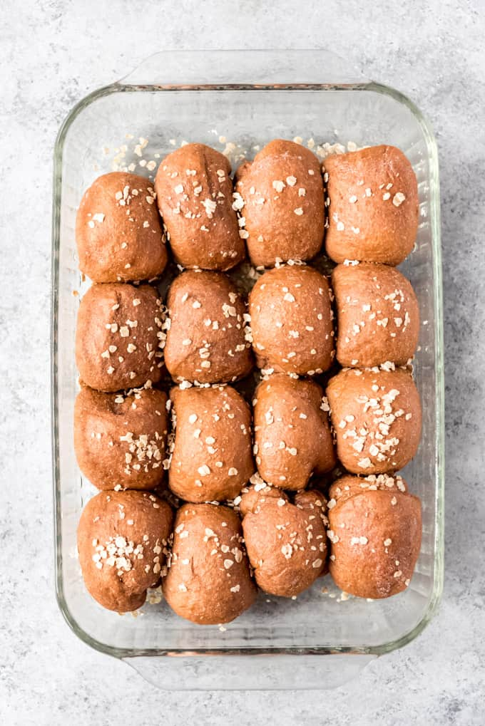 overhead shot of whole wheat dinner rolls in glass dish