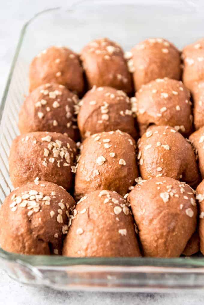 angle shot of whole wheat dinner rolls in glass dish