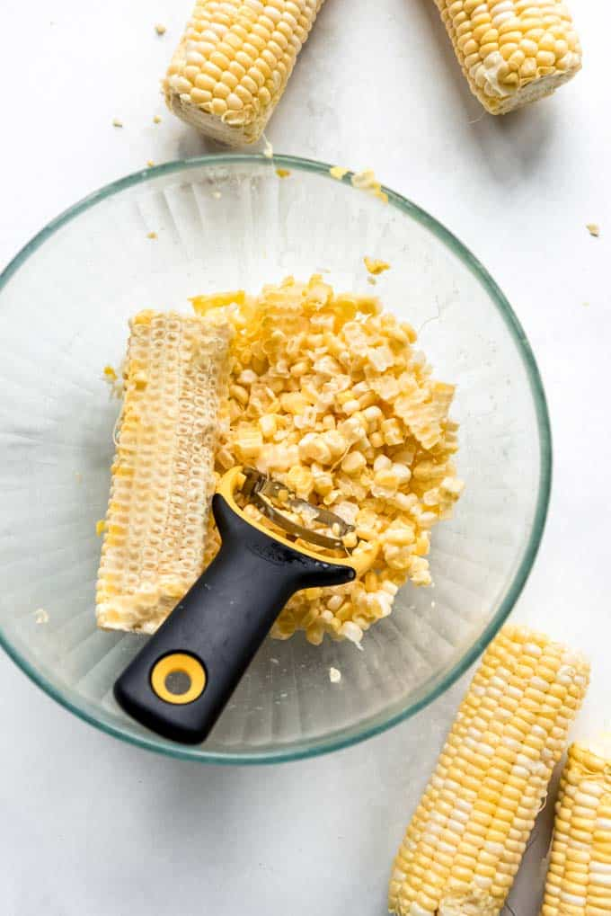 A bowl of corn kernels stripped from the cob.