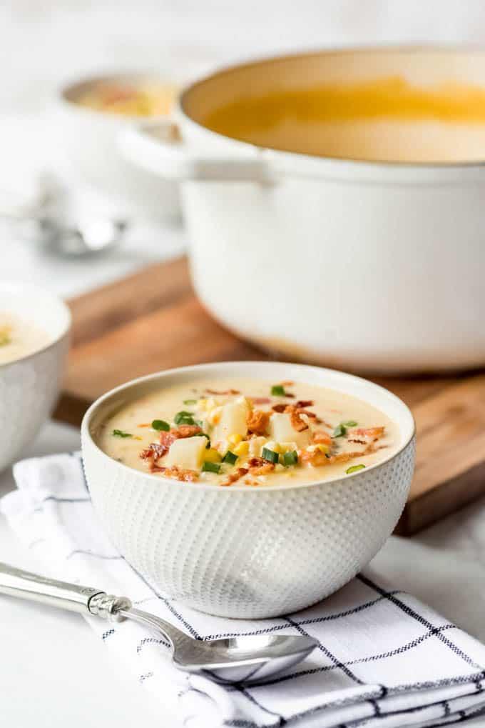 A bowl of potato corn chowder.