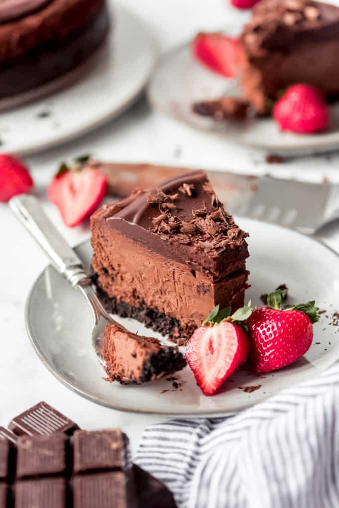a slice of Triple Chocolate Cheesecake with strawberries