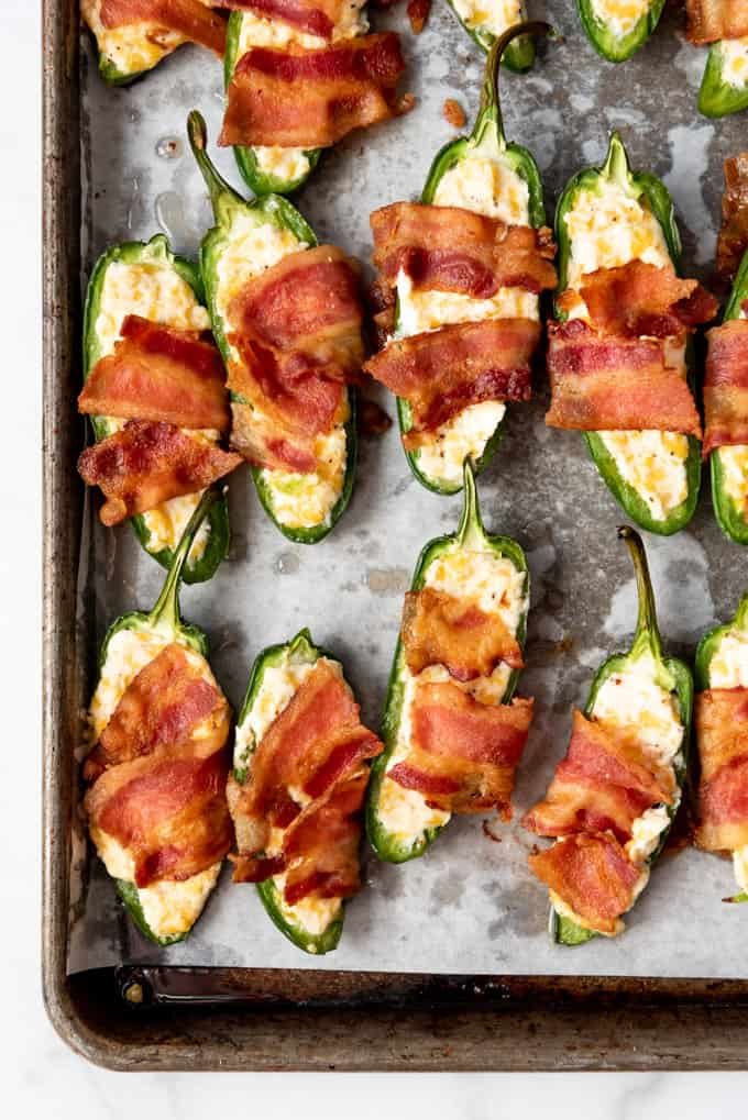 Jalapeno poppers with bacon on a baking sheet