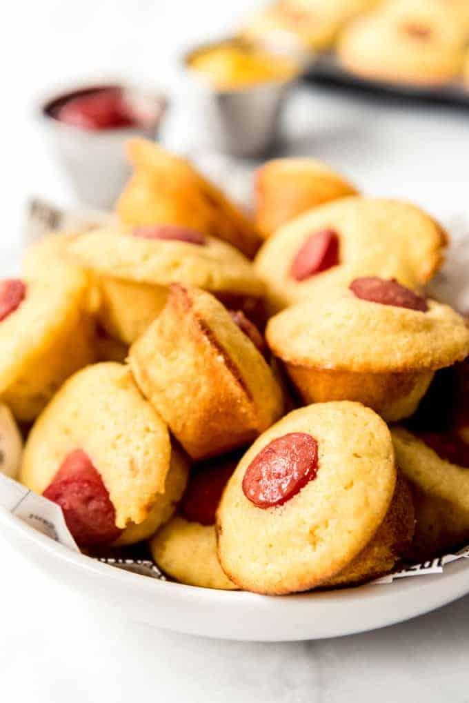 Corn dog mini muffins piled in a bowl.