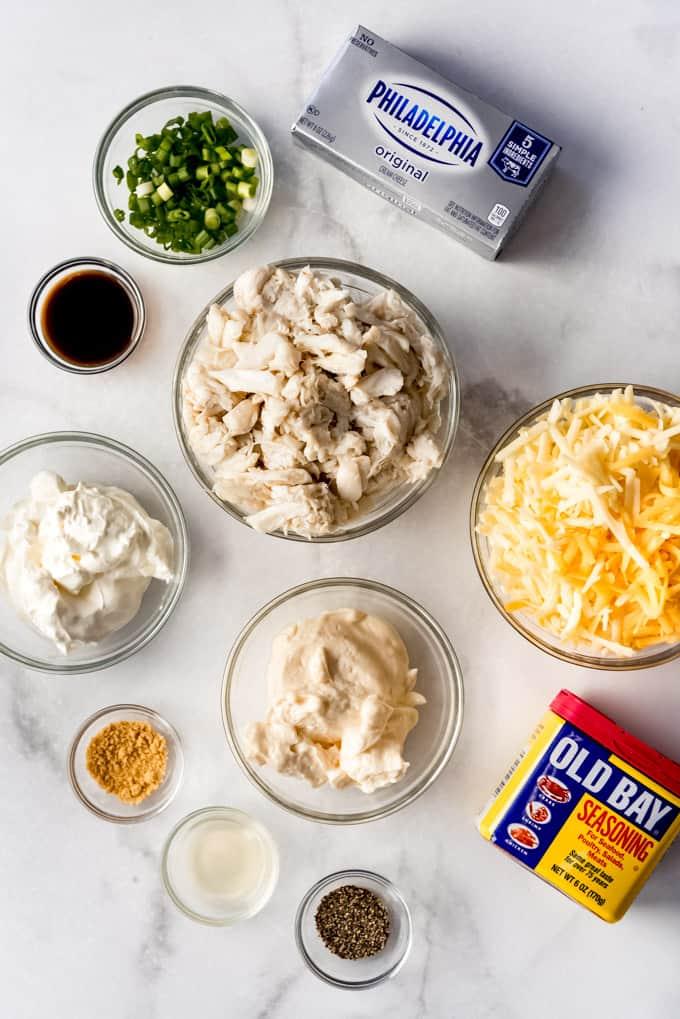 hot crab dip ingredients in individual bowls