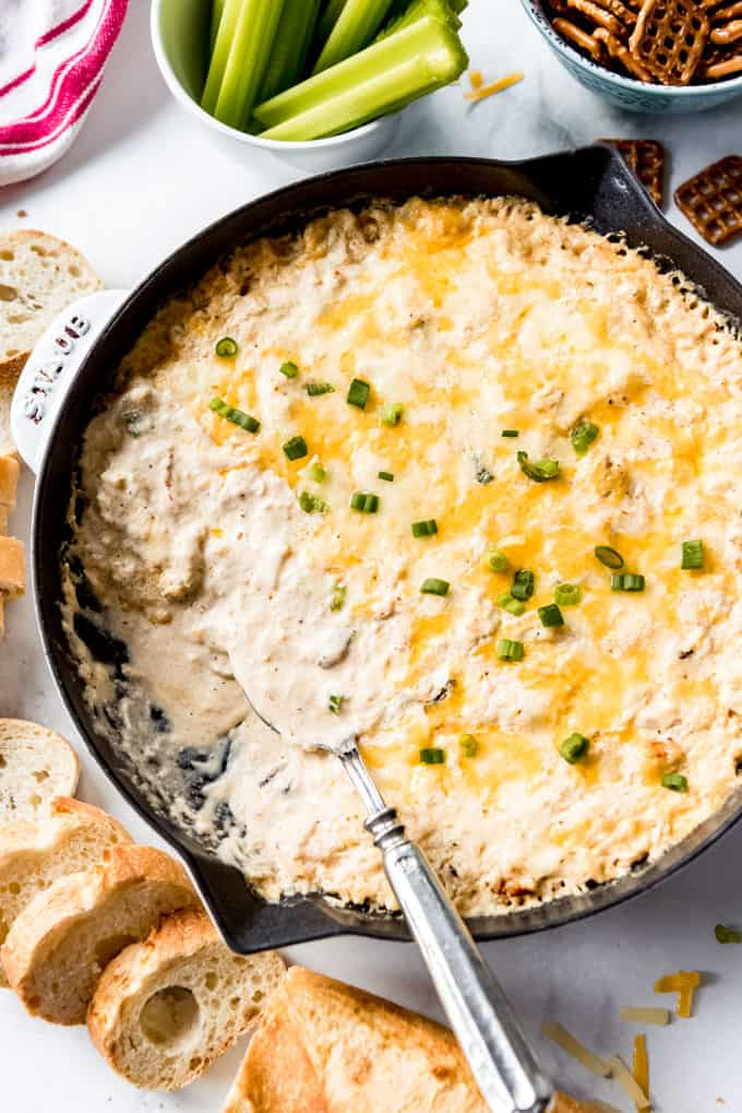 creamy crab dip in a skillet with a spoon