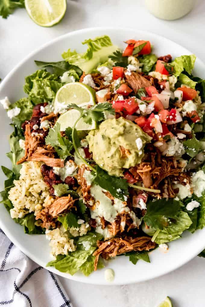 a copycat cafe rio sweet pork salad on a plate