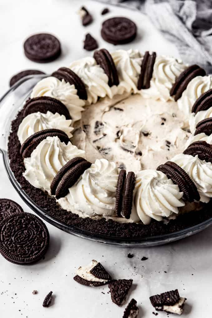 side view of full oreo pie on table with cookies