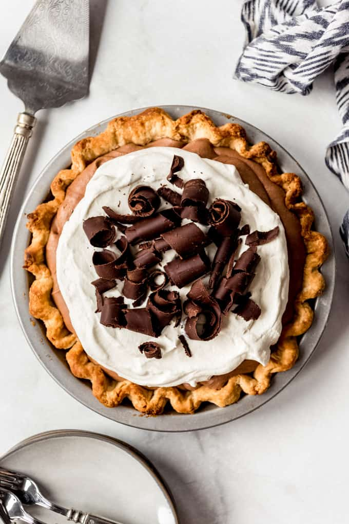 a homemade french silk pie with chocolate curls on top