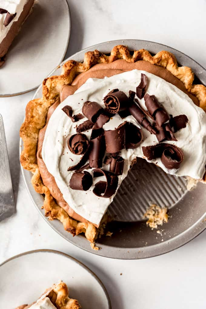 a chocolate French silk pie with slices taken out of it