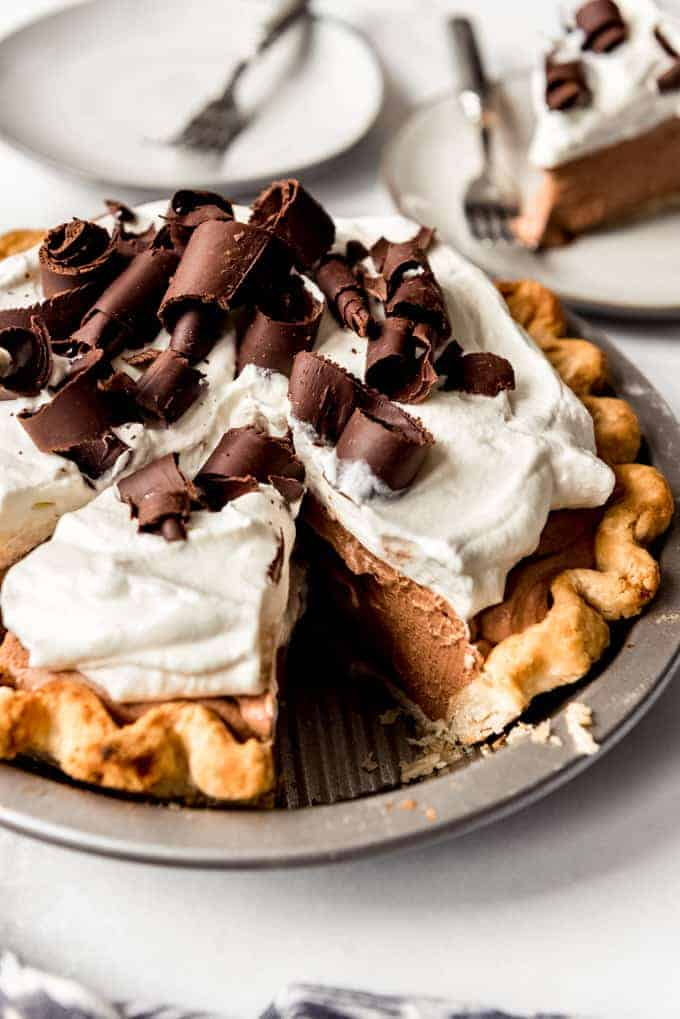 a homemade french silk pie with whipped cream on top