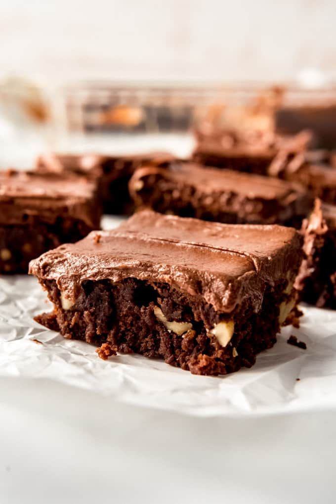 a frosted brownie with walnuts