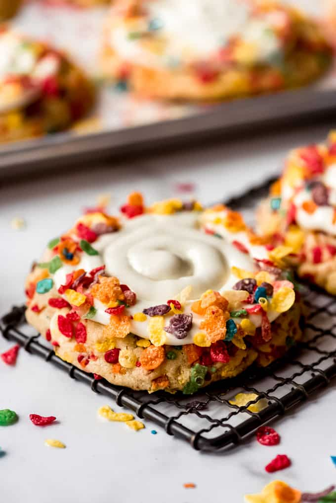 Close up of Frosted Fruity Pebble Cookie on cooling rack