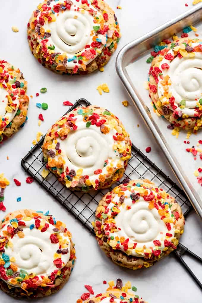 oversized gourmet fruity pebbles cookies on a wire rack