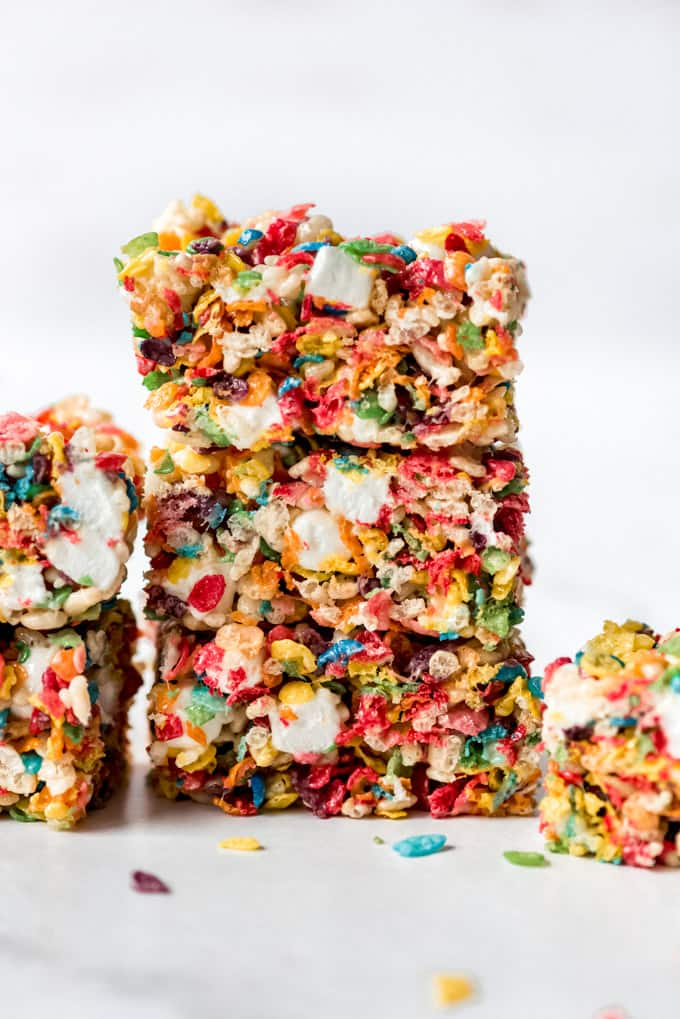 A stack of three rice crispy treats made with fruity pebbles cereal