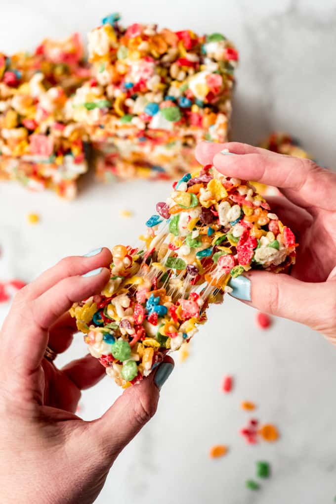 A soft rice krispie treat being pulled apart.
