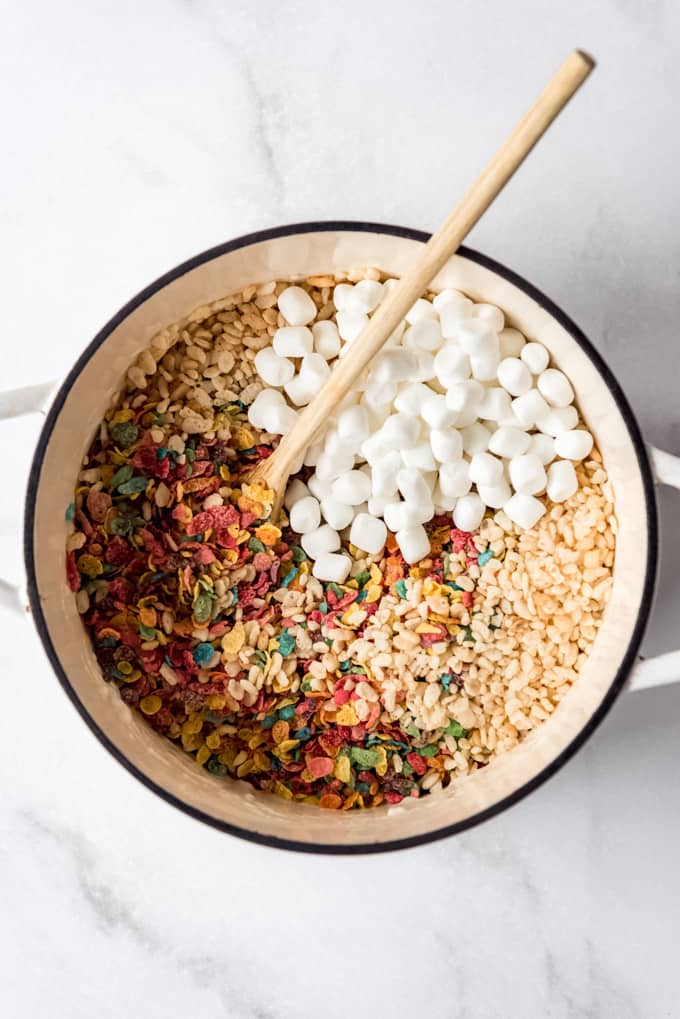 Marshmallows and cereal in a large pot.