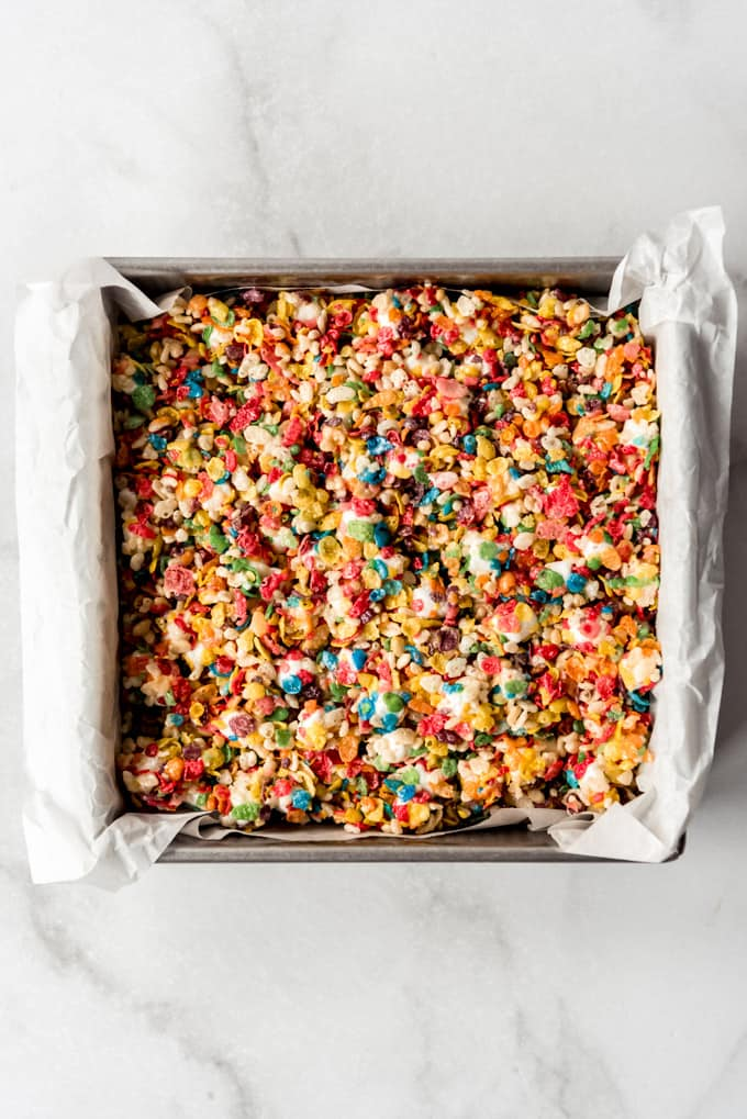Colorful rice krispie treats pressed into a square pan.