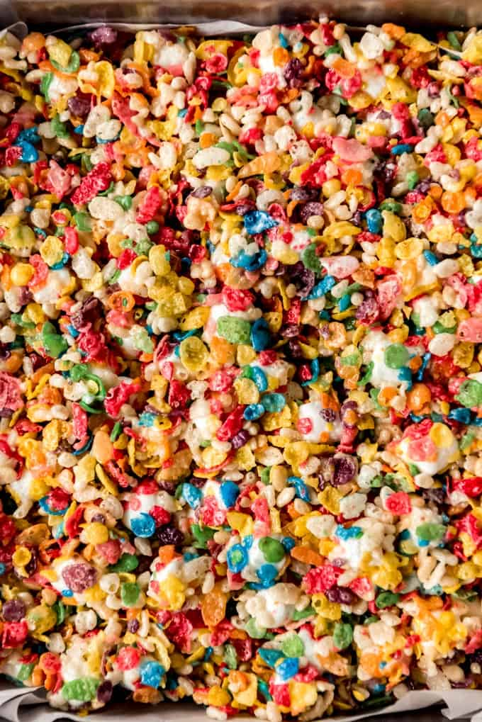 A close shot of the top of rice krispie treats made with fruity pebbles cereal.