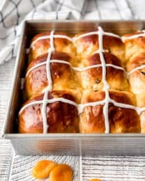 side view of Easter hot cross buns in a pan