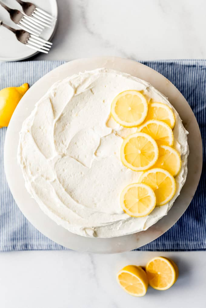 a cake decorated with thin slices of lemon on top