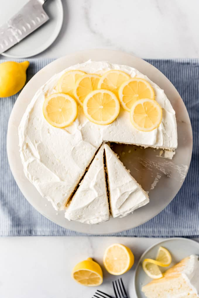 a lemon cake with slices cut out of it