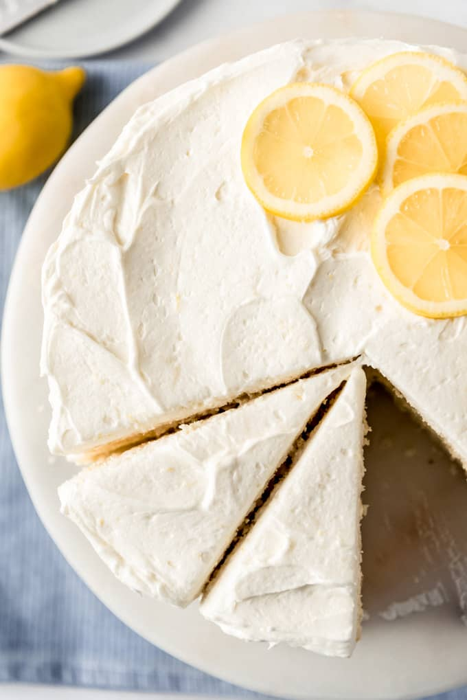 a close shot of a lemon layer cake that has been cut into slices
