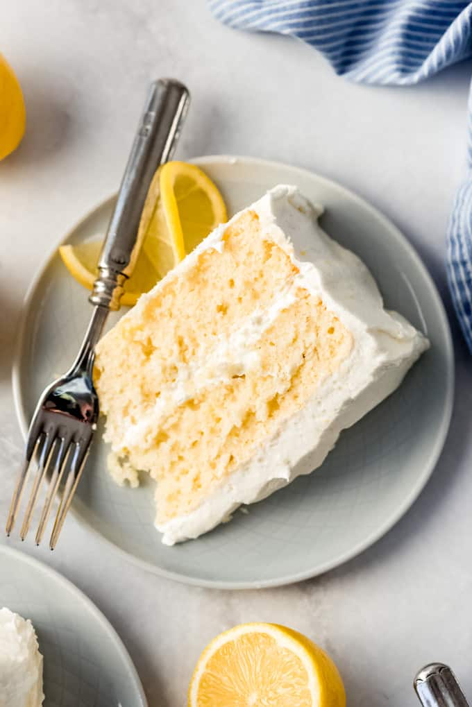 a piece of lemon cake with two layers